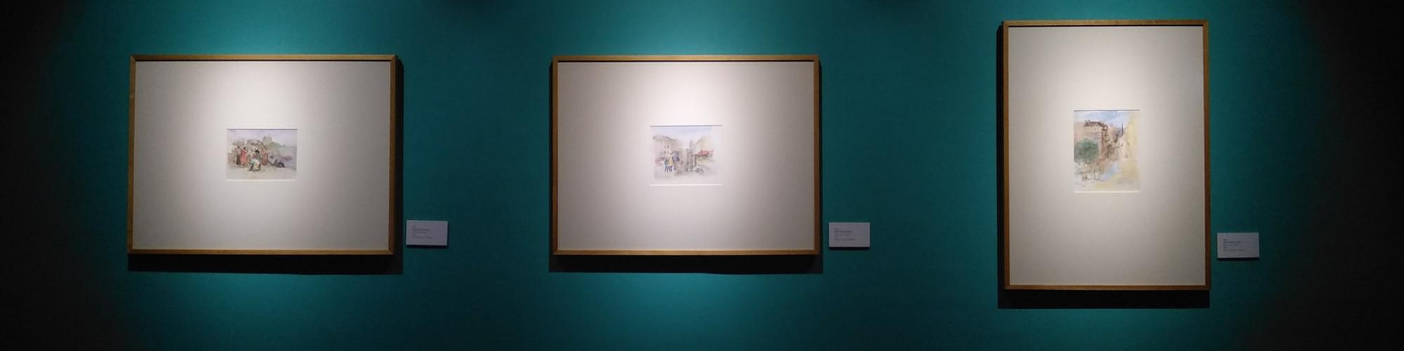 three-paintings-hanging-in-gallery-1674049