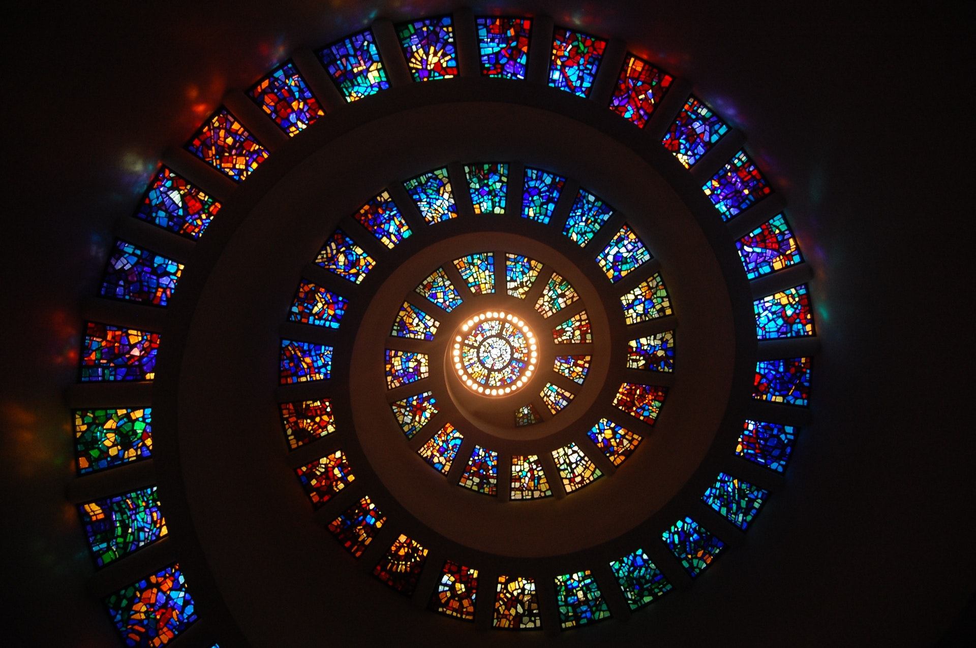 worms-eye-view-of-spiral-stained-glass-decors-through-the-161154
